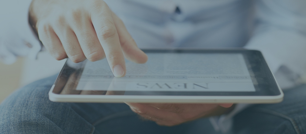 man reading news on the digital tablet